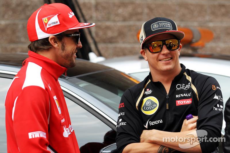 Fernando Alonso, Ferrari with Kimi Raikkonen, Lotus F1 Team