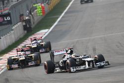 Pastor Maldonado, Williams leads Jean-Eric Vergne, Scuderia Toro Rosso and Daniel Ricciardo, Scuderia Toro Rosso