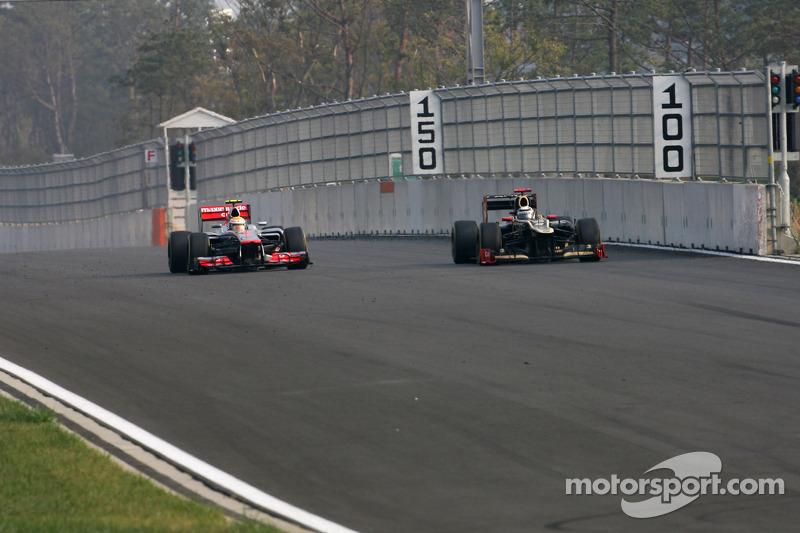 Lewis Hamilton, McLaren Mercedes en Kimi Raikkonen, Lotus F1 Team