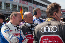 Audi and Toyota principals enjoying fan performances in grandstands