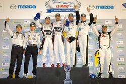 ALMS championship podium: P1 champions Klaus Graf and Lucas Luhr, P2 champions Scott Tucker, Christophe Bouchut, GT champions Oliver Gavin, Tom Milner, PC champion Alex Popow