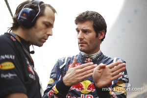 Mark Webber, Red Bull Racing on the grid with Ciaron Pilbeam, Red Bull Racing Race Engineer