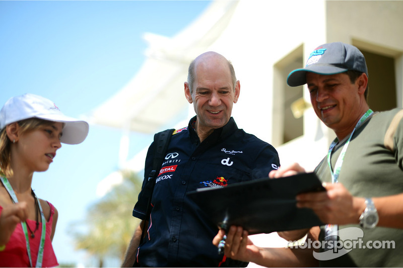 Adrian Newey, Red Bull Racing Chief Technical Officer signs autographs for the fans