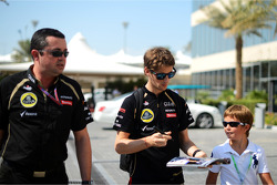 Romain Grosjean, Lotus F1 and Eric Boullier, Lotus F1 Team Principal