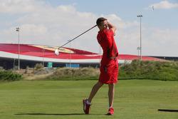 James Courtney golfs