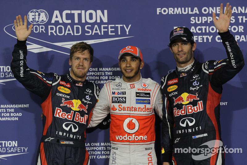 Ganador de la pole Lewis Hamilton, McLaren Mercedes, segundo puesto Mark Webber, Red Bull Racing y e