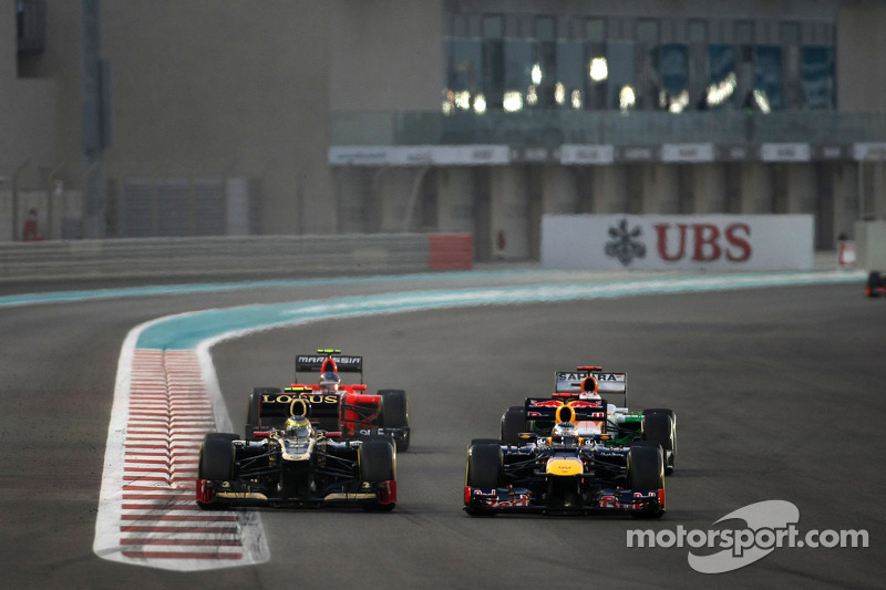 Romain Grosjean, Lotus F1 Team en Sebastian Vettel, Red Bull Racing