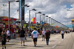 Fans walk the pitlane