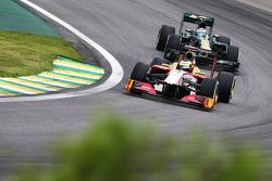 Pedro De La Rosa, HRT Formula 1 Team leads Vitaly Petrov, Caterham