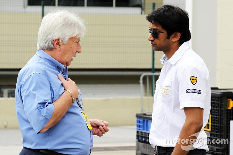 Herbie Blash, FIA Delegate with Narain Karthikeyan, Hispania Racing F1 Team