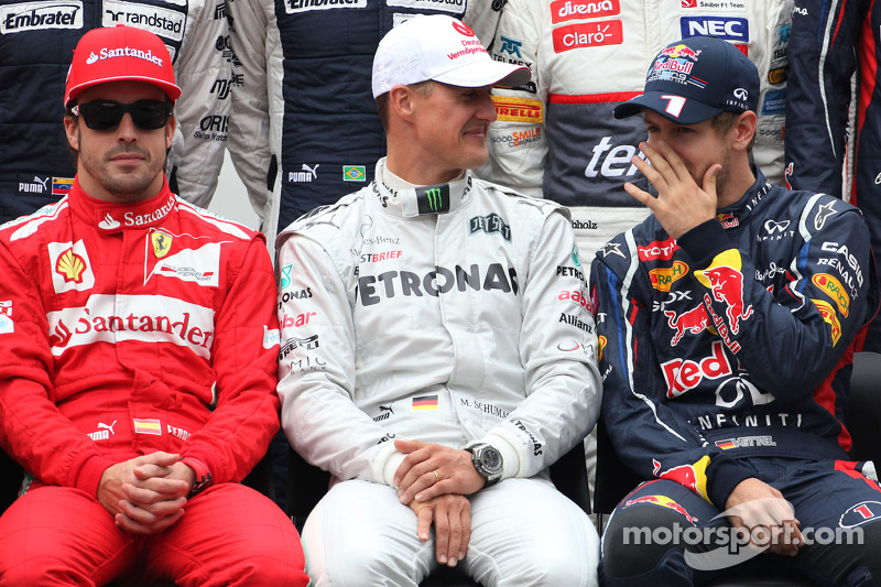 Fernando Alonso, Scuderia Ferrari, Michael Schumacher, Mercedes GP, y Sebastian Vettel, Red Bull Racing