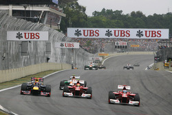 Mark Webber, Red Bull Racing, Felipe Massa, Ferrari, and Fernando Alonso, Ferrari battle for position