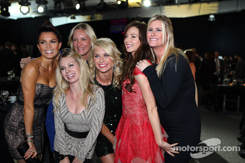 Drivers' wives and girlfriends pose for a photo