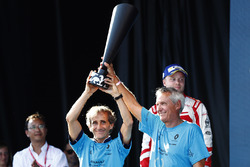 Alain Prost and Jean Paul Driot lift the manufacturers trophy on the podium for Renault eDams