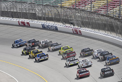 Austin Cindric, Brad Keselowski Racing Ford, Christopher Bell, Kyle Busch Motorsports Toyota, and Darrell Wallace Jr., MDM Motorsports Chevrolet lead the field into turn one