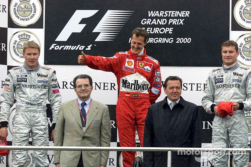 Podium: race winner Michael Schumacher, second place Mika Hakkinen, third place David Coulthard