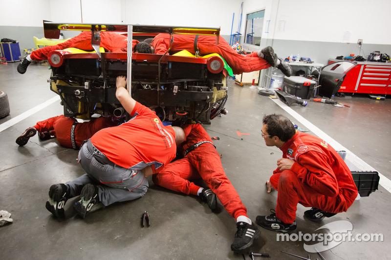 #64 Scuderia Corsa Ferrari 458 in the garage with mechanical issues