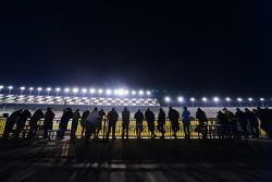 Fans watch practice action