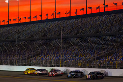 Joey Logano, Penske Racing Ford leads a group of cars
