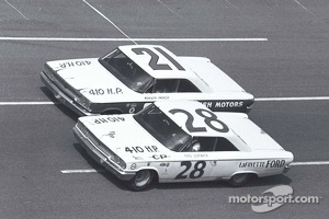 Tiny Lund and Fred Lorenzen race side by side