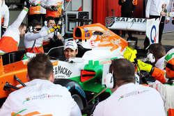Adrian Sutil, Sahara Force India VJM06 practices pit stops with the team