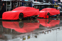 The cars of Jamie McMurray and Juan Pablo Montoya in the rain