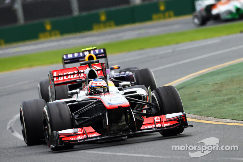 Jenson Button, McLaren MP4-28 leads Mark Webber, Red Bull Racing RB9
