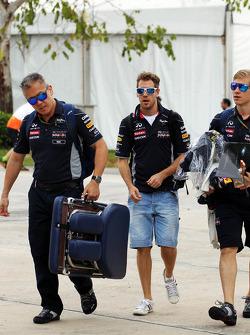 Sebastian Vettel, Red Bull Racing with Heikki Huovinen, Personal Trainer, and Paul Cheung, Red Bull Racing Team Chiropractor