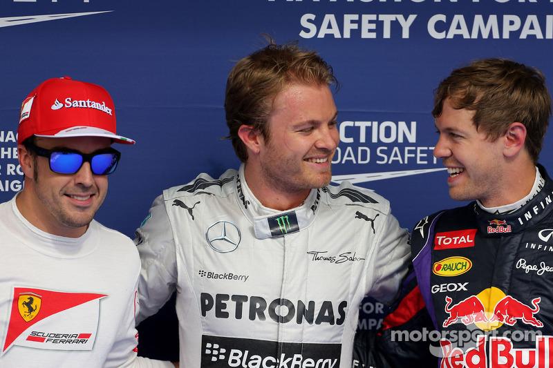Fernando Alonso, Ferrari, tercero; Ganador de la pole position Nico Rosberg, Mercedes AMG F1 y Sebas