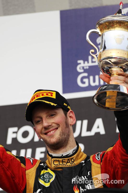 Romain Grosjean, Lotus F1 Team comemora sua terceira posição no pódio