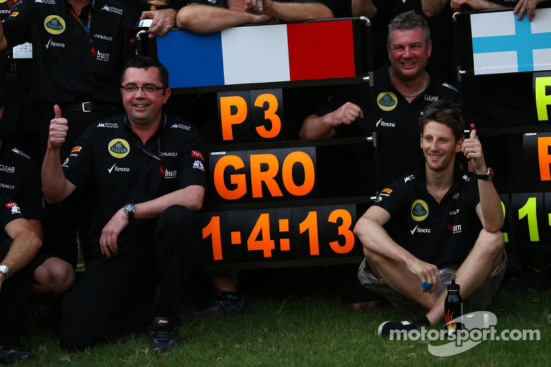 Eric Boullier, Lotus F1 Team Principal and Romain Grosjean, Lotus F1 E21