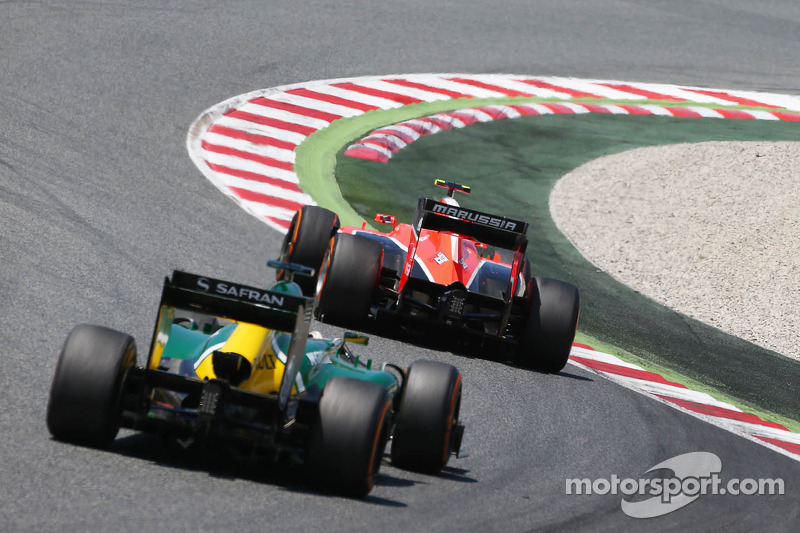Max Chilton, Marussia F1 Team MR02 leads Charles Pic, Caterham CT03