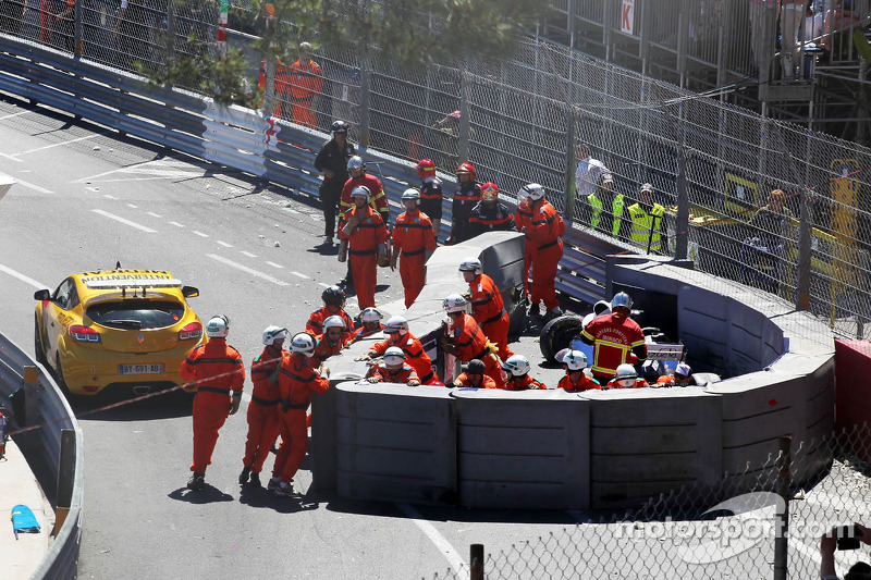 Marshals repair the damaged airfence after Pastor Maldonado, Williams FW35 crashed and stopped the race