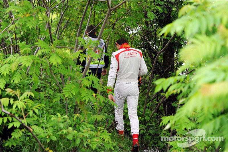 Jules Bianchi, Marussia F1 Team walks through the undergrowth after stopping in the first practice s