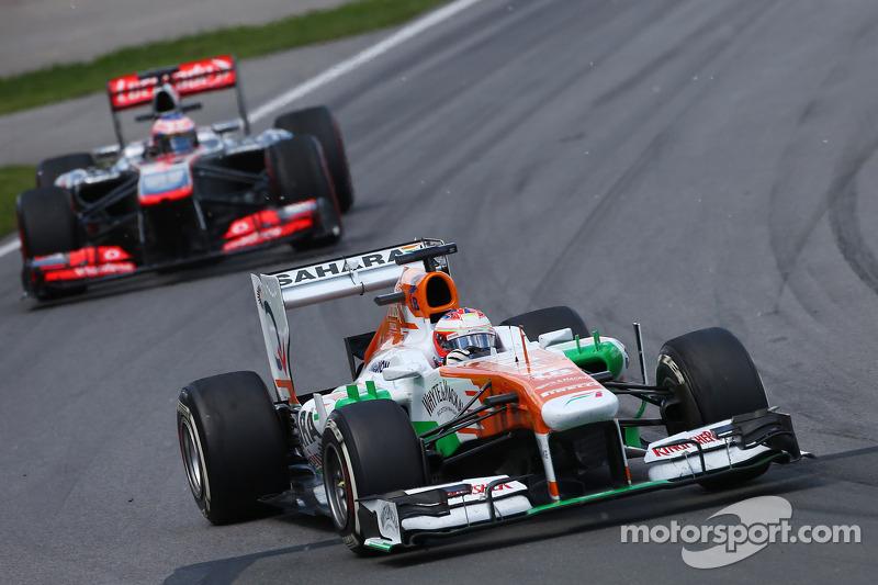 Paul di Resta, Sahara Force India VJM06 leads Jenson Button, McLaren MP4-28