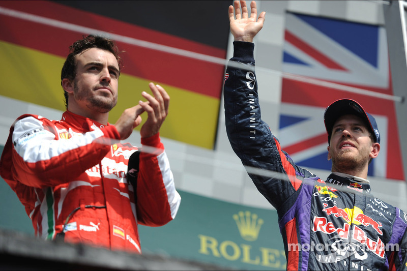 Race winner Sebastian Vettel, Red Bull Racing celebrates on the podium with second placed Fernando Alonso, Ferrari
