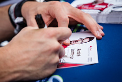 Andre Lotterer signs an autograph