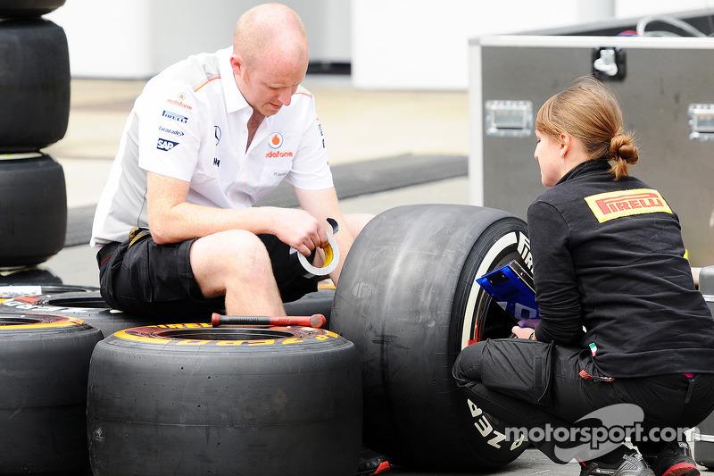 McLaren mechanic with a Pirelli Tyre Engineer.