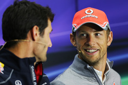 Mark Webber, Red Bull Racing and Jenson Button, McLaren in the FIA Press Conference.