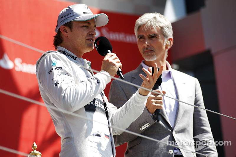 Race winner Nico Rosberg Mercedes AMG F1 on the podium with Damon Hill Sky Sports Presenter