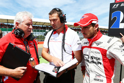 Pat Symonds Marussia F1 Team Technical Consultant with Jules Bianchi Marussia F1 Team on the grid