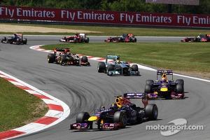 Sebastian Vettel, Red Bull Racing RB9 leads at the start of the race