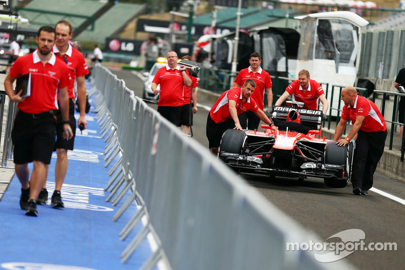 A Marussia F1 Team MR02 is pushed down the pit lane