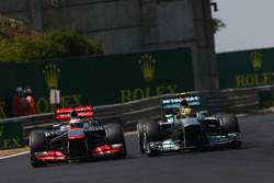 Jenson Button, McLaren MP4-28 and Lewis Hamilton, Mercedes AMG F1 W04 battle for position