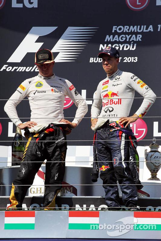 (Da esquerda para direita): Kimi Raikkonen, Lotus F1 Team, e Sebastian Vettel, Red Bull Racing, no p