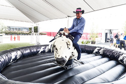 David Coulthard, Commentator, Channel 4 F1, tries his hand on a mechanical rodeo bull