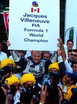 Jacques Villeneuve and his Williams crew celebrate Drivers World Championship title