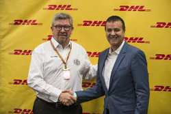 Ross Brawn, Managing Director of Motorsports, FOM, shakes hand with a representative of DHL