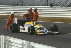Nelson Piquet, Williams FW11B Honda with marshalls