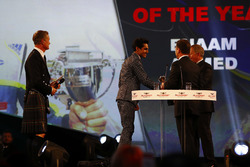 Enaam Ahmed receives an Award from Christian Horner and Martin Brundle